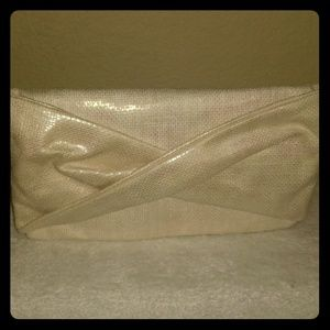 Charming Charlie Shiny Cream colored Clutch Bag